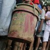 Survivors line up for water at a community wiped out by devastating floods by Ketsana in the Philippines capital Manila