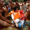 菲律宾受灾民众。联合国儿童基金会图片