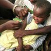 A child being vaccinated against measles