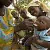 A woman gives a toddler a spoonful of oral rehydration salts to treat diarrhoeal dehydration.