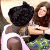 Hilde Johnson talks to a participant in a UNICEF-sponsored programme for survivors of sexual and gender-based violence.