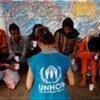 UNHCR staff member interviews asylum-seekers