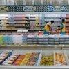 Stacking supermarket shelves in Malawi