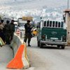 Israeli soldiers inspect Palestinians' documents at the Hawera checkpoint outside Nablus town in the West Bank