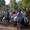 Garment workers going home on motorcycles in Cambodia