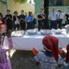 Chinese FPU and UNPOL Officers applaud during a distribution of food and Christmas presents to children.
