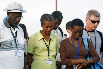 Staff members from the UN Stabilization Mission in Haiti (MINUSTAH) observe a moment of silence for their fallen colleagues during a memorial service in Port-au-Prince, Haiti.