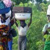Women and children fleeing past unrest in Plateau State, Nigeria