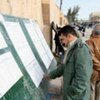Kurdish voter looking for his name on the voters' lists outside the polling centres in Erbil, Iraq