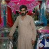 Former journalist Rehman Faizai now sells traditional Afghan cloths at a market in Islamabad.