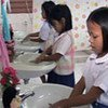 5-year-old Yupa washes her hands with classmates in the child-friendly bathrooms at her school