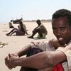An exhausted survivor of the dangerous sea crossing to Yemen from the Horn of Africa