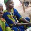 Des femmes pilant du riz au Burkina Faso.