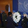 Deputy Secretary-General Asha-Rose Migiro (second from right) and UN peacekeepers at wreath-laying ceremony