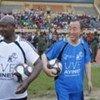 Secretary-General Ban Ki-moon and President Museveni of Uganda play football as part of War Victims Day