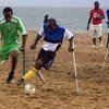 Sierra Leonean amputees take part in football exhibition game.