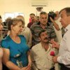 High Commissioner for Refugees António Guterres (right) meets refugees at a community centre in southern Beirut