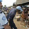 Police Officers of the UN Operation in Côte d'Ivoire patrol market area