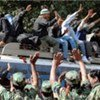 Maoist army members bid farewell to young people discharged from cantonments in western Nepal on 30 January 2010