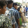 Former IDPs queue for relief supplies in Batticaloa District, Sri Lanka