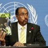Michel Sidibé, UNAIDS Executive Director, with the <i>Outlook</i> report