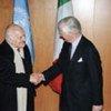 Under-Secretary-General Marrack Goulding (right) greets President Oscar Luigi Scalfaro of Italy on 3 April 1996