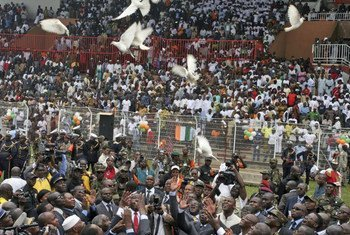 Doves are released  to mark the beginning of the disarmament and reconciliation process in Bouake, Côte d'Ivoire.