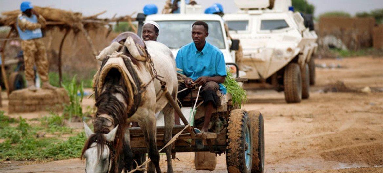 UNAMID peacekeepers patrol the Kalma Camp for internally displaced people in Nyala, South Darfur, Sudan