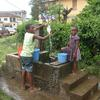 Children at a public fountain in Malabo, the capital of Equatorial Guinea, wait for the daily arrival of water