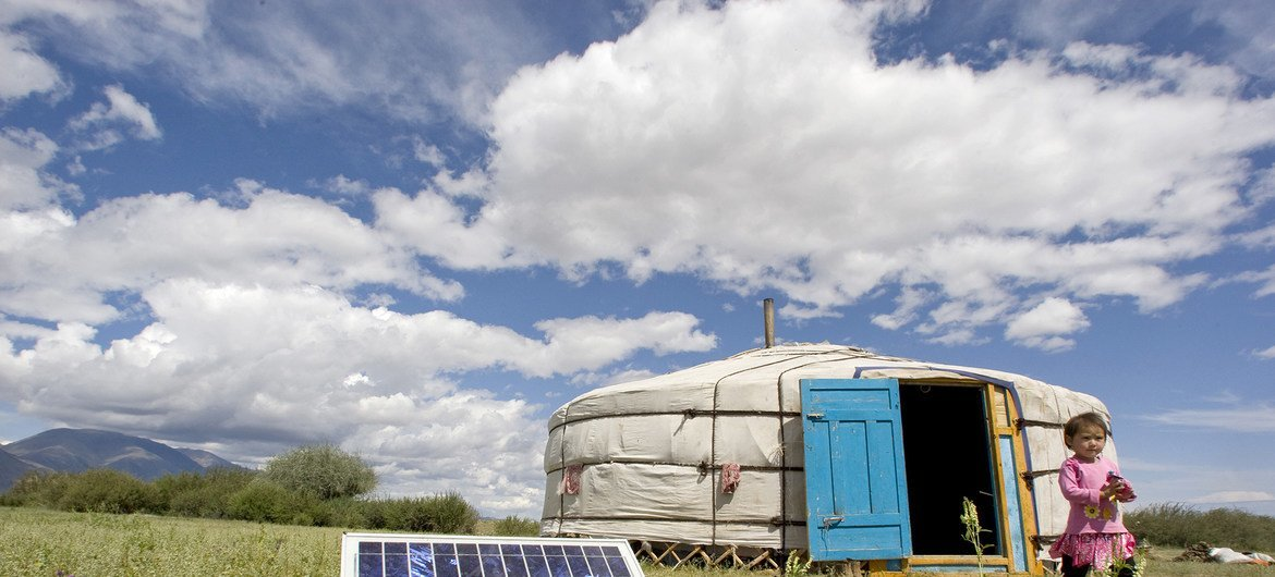 A family in Uvs Province, Mongolia, using a solar panel to generate power for their ger, a traditional Mongolian tent.