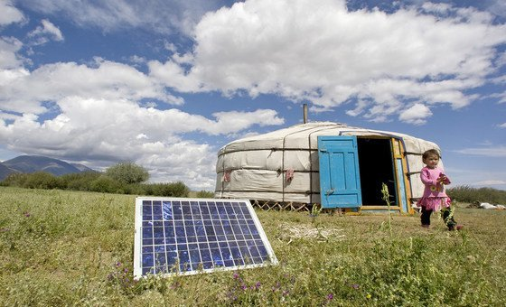 A family in Uvs Province, Mongolia, using a solar panel to generate power for their ger, a traditional Mongolian tent. UN Photo/E. Debebe