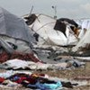 A deadly rainstorm lashed Haiti's capital, Port-au-Prince, on 24 September 2010 leaving people in urgent need of shelter materialAt least 1 million people are still living in tent camps or makeshift housing