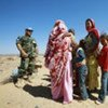 A MINURSO officer chats with a group of local Western Saharans
