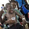 A Haitian boy suffering from acute diarrhoea is fed an intravenous rehydrating solution at St. Nicholas Hospital