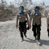 Rescue workers arrive at the scene of the Mount Merapi volcano in Indonesia
