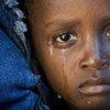 Un enfant traité pour le choléra pleure dans un centre médical dans le département d'Artibonite en Haïti.