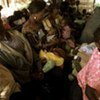 Congolese refugees in the back of a truck after returning to Katanga province from Zambia
