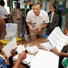 An observer speaks with staff of a polling station during voting in Côte d'Ivoire's run-off elections on 28 November 2010