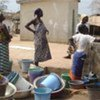 Women who fled their villages collect water in Guiglo, western Côte d'Ivoire