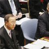 Secretary-General Ban Ki-moon (left) listens as Vice President Joe Biden of the United States chairs Security Council meeting on Iraq
