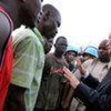 Special Envoy Y.J. Choi (right) speaks with injured pro-Alassane Ouattara supporters in Abidjan