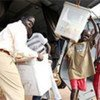 Residents of the road-less Tali region of Central Equatoria State unloading voting materials from UNMIS helicopter