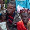 A group of refugees from Côte d'Ivoire waiting to be registered in eastern Liberia