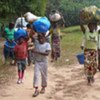 Ivorian refugees, photographed inside Liberia, walking from their village in Côte d'Ivoire with just a few possessions