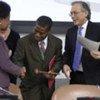 Deputy Secretary-General Asha-Rose Migiro (left) and outgoing ECOSOC President Hamidon Ali (right) congratulate Lazarous Kapambwe of Zambia