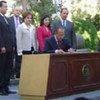President Felipe Calderón signs Mexico's new legislation on refugees and asylum-seekers