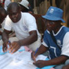 Staff from UNHCR and the International Organization for Migration register displaced people in western Côte d'Ivoire