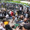 Ivorians injured during a march in December 2010 arrive at UNOCI Headquarters for treatment