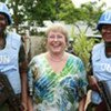 Executive Director of UN Women Michelle Bachelet is flanked by female peacekeepers in Liberia