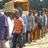 Ivorian refugees in northern Liberia stand in line to receive food rations of cereals, vegetable oil, pulses and corn soya blend